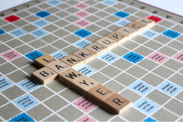 """A Scrabble board, spelling the words """"bankruptcy"""" and """"lawyer"""""""