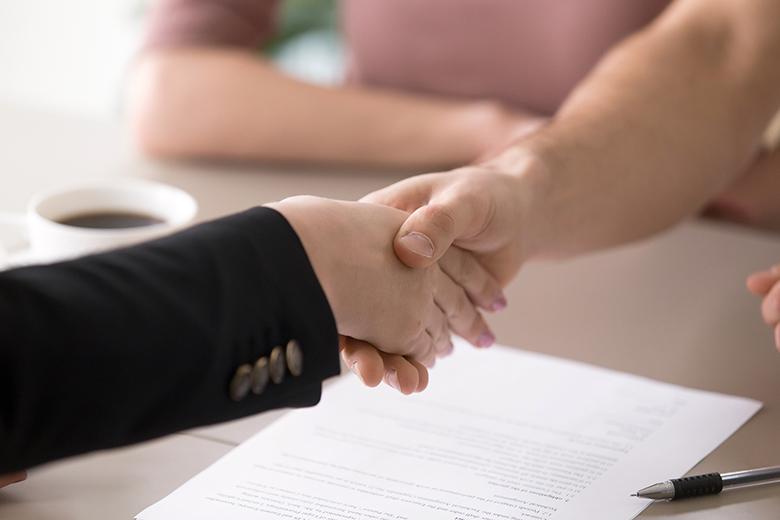 Man and woman handshaking